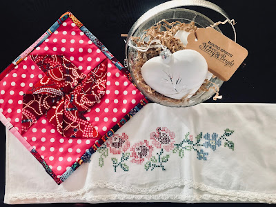 Photo of homemade pot holder, pillow cases and white holiday ornaments