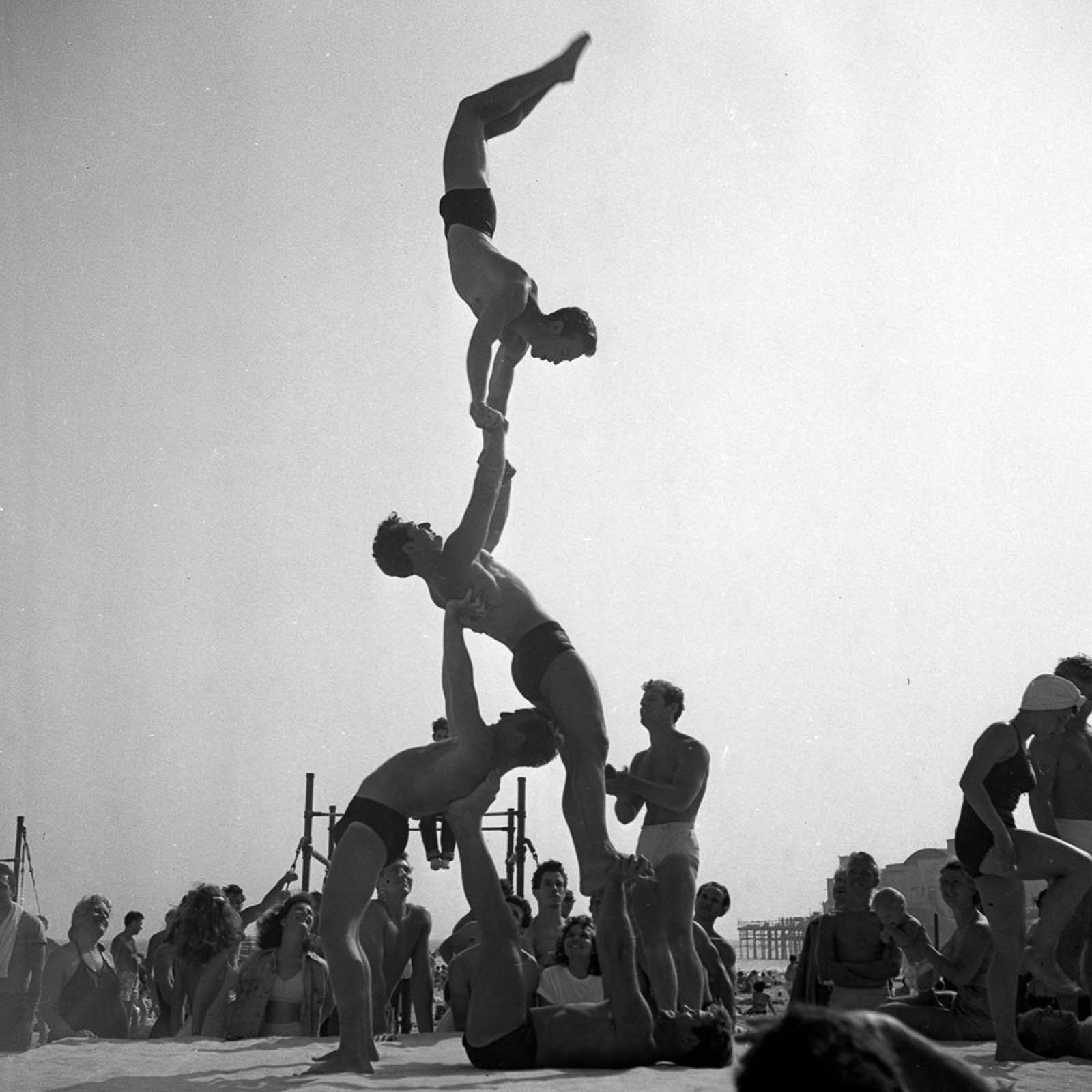 Male and female gymnasts regularly put on public shows, dazzling beachgoers with their displays of strength and balance.