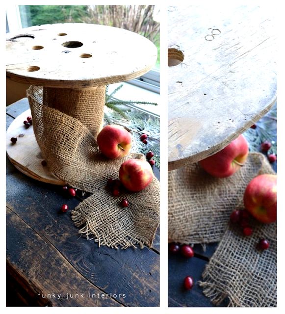 Mini antique spool with burlap ribbon and apples with cranberries Christmas vignette.
