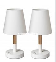 Logo Vinci gratis una lampada da scrivania Tomons