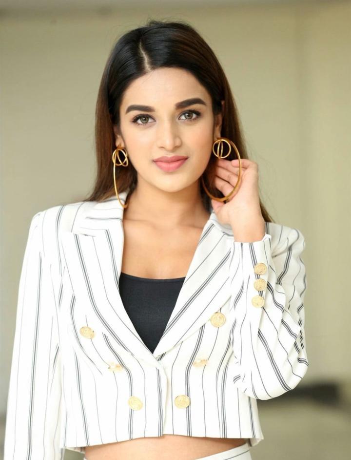 Indian Hot Model Nidhi Agarwal In White Shirt Pant At Pega Teach For Change