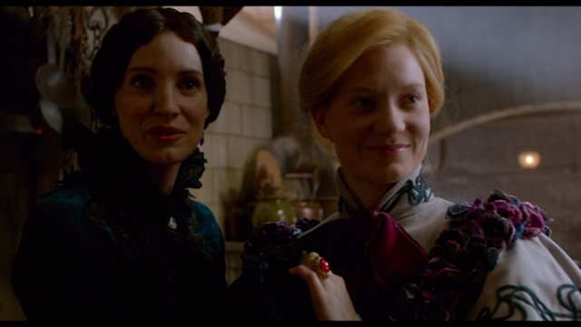 The moth and the butterfly: Lucille Sharpe (Jessica Chastain) and Edith Cushing (Mia Wasikowska) in CRIMSON PEAK (2015).