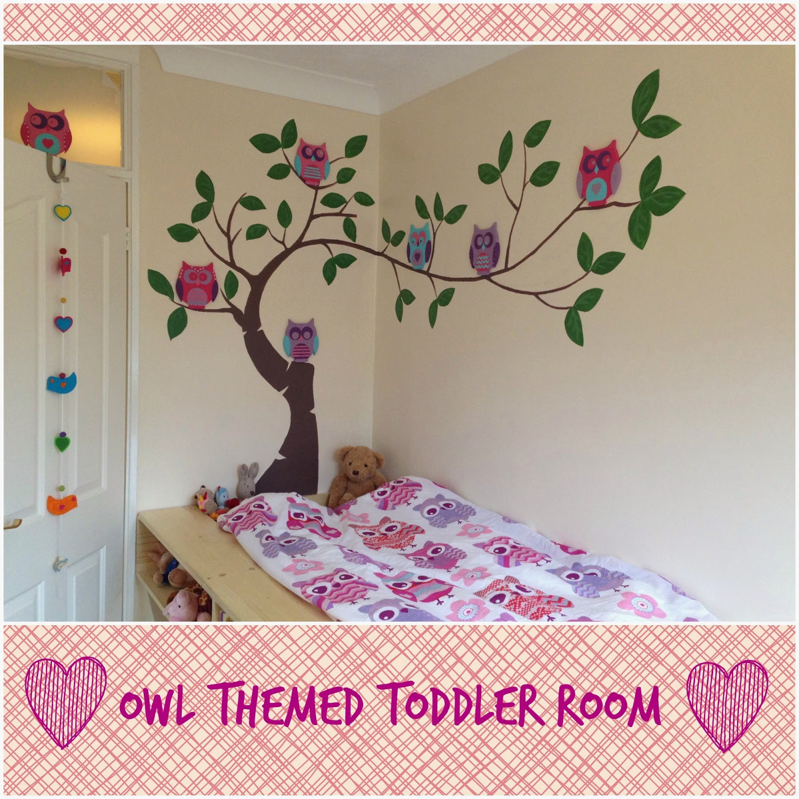 Tree with owls painted above a toddler bed