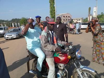 Photos of Ayo Fayose on a motorcycle in Ado Ekiti