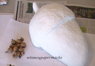 Paper Mache and Paper Clay Acorn with primer coat of paint