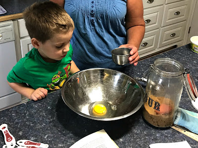 June 20, 2018 Watching my sister bake with her grandson