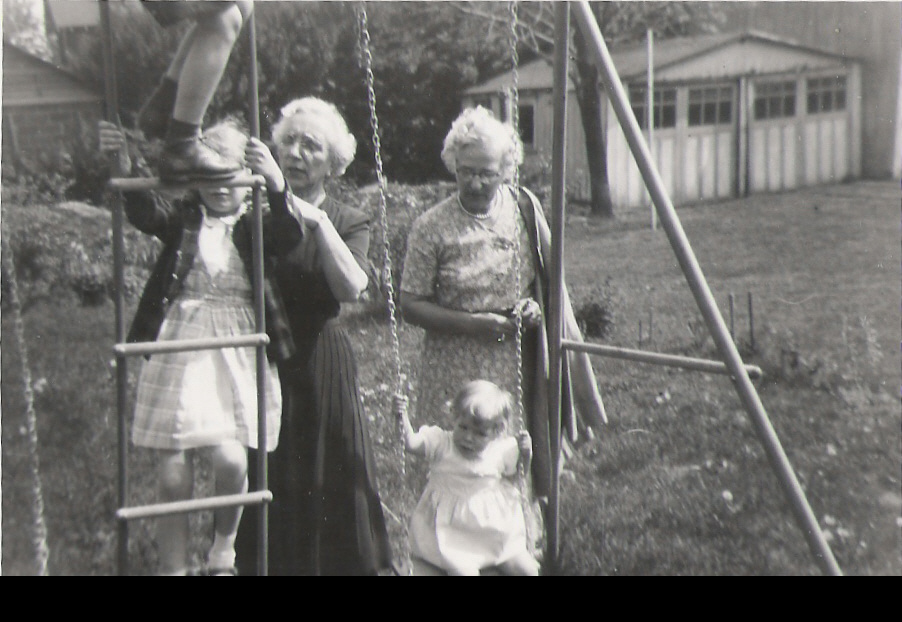 gandmother and children by the swing set
