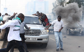 Raila Odinga teargased and rushed out of the protest scene.