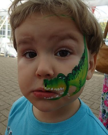 Big Boy with a Dinosaur painted on his face