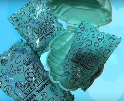 Пакетики с сюрпризами и шар-ракушка ЛОЛ Сюрприз