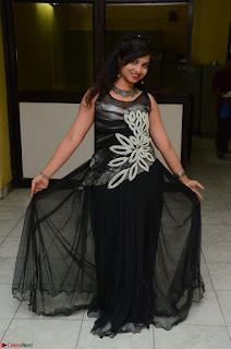 Shrisha Dasari in Sleeveless Short Black Dress At Follow Follow U Audio Launch 064.JPG