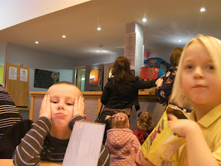 eating crisps and M+M cakes in krazy Kaves portsmouth