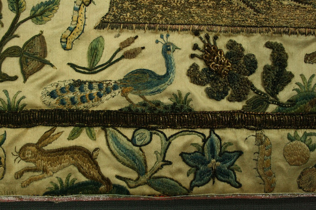 Detail of symbolism in 17th century English stump work embroidery, conserved at the textile conservation studio of Spicer Art Conservation, New York