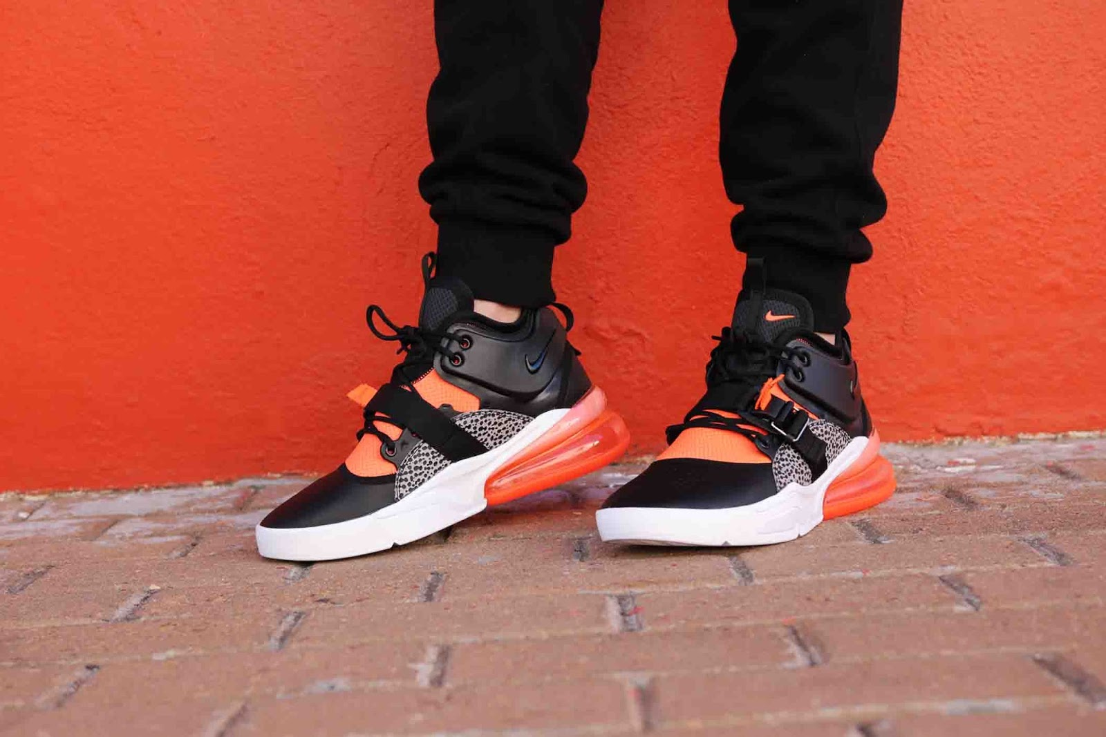 9fa2e274534 A vibrant explosion of colour hits the Air Force 270. The orange colourway  is stamped across the forefoot as well as the ankle surround and Vapormax  Unit in ...