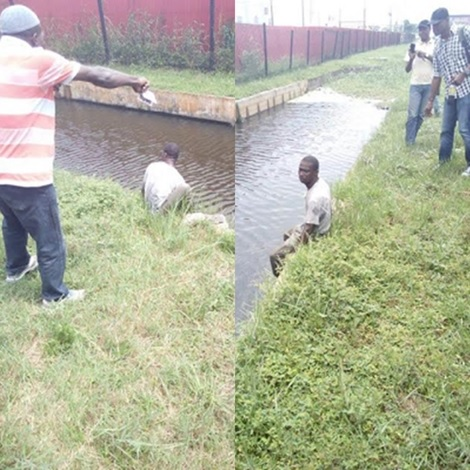 Moment Lagos Bus Conductor Jumped Into Canal After Plan to Abandon Passengers Backfires (Photos)