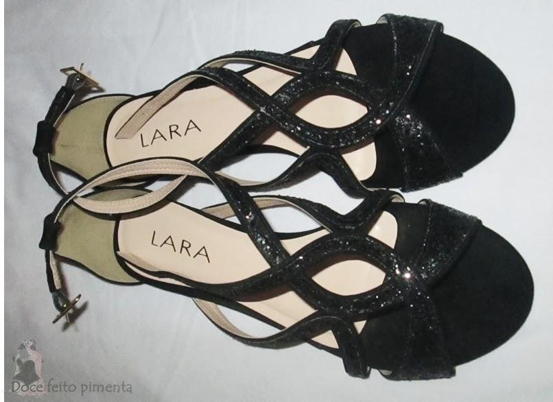 http://www.passarela.com.br/feminino/produto/6091042912/Sandalia-Rasteira-Lara-546-02167----Preto/