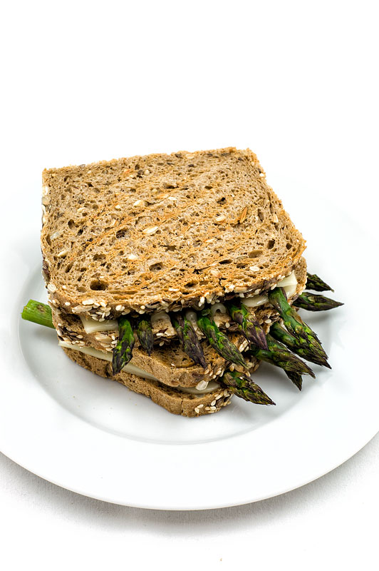 Vegan hot asparagus sandwich grilled on plate