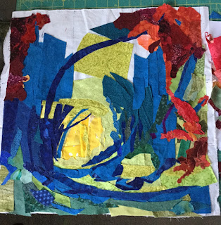 Reds and oranges are starting to appear in the art quilt