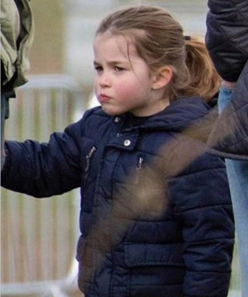 Princess Charlotte. Prince George wore Columbia fleece jacket, Kate Middleton wore Barbour longshore quilted jacket