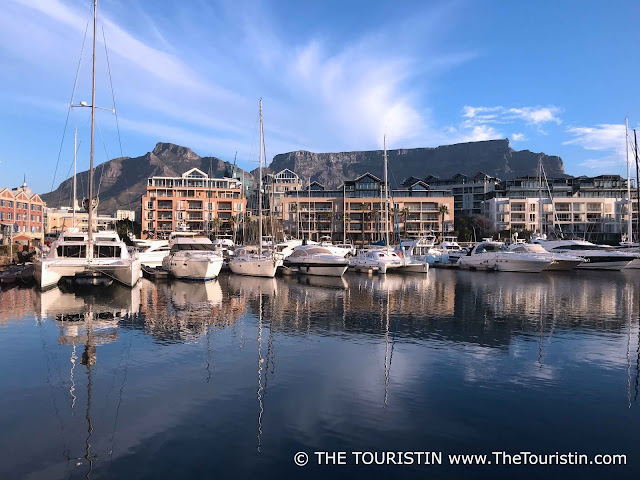 View over the harbour and Table Mountain under a blue sky with cloud formations