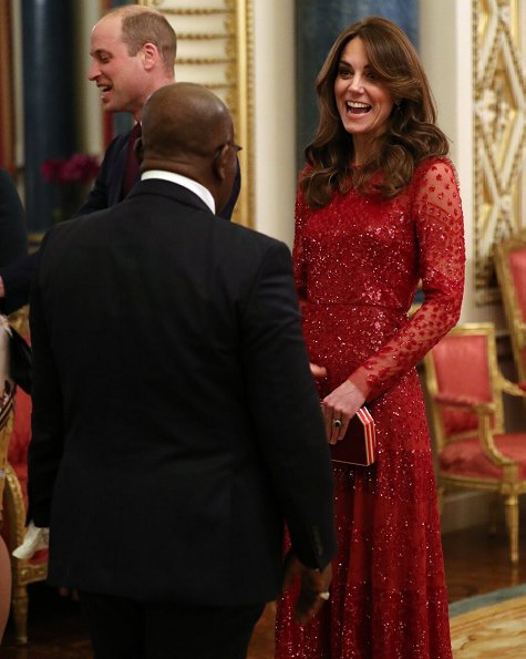 Kate Middleton wore a new red sequined tulle gown by Needle and Thread. The Countess of Wessex wore a stripe knit dress by Alaïa