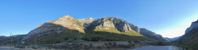 Base of Wasatch Mountains in shadow, peaks bright in morning light with blue sky