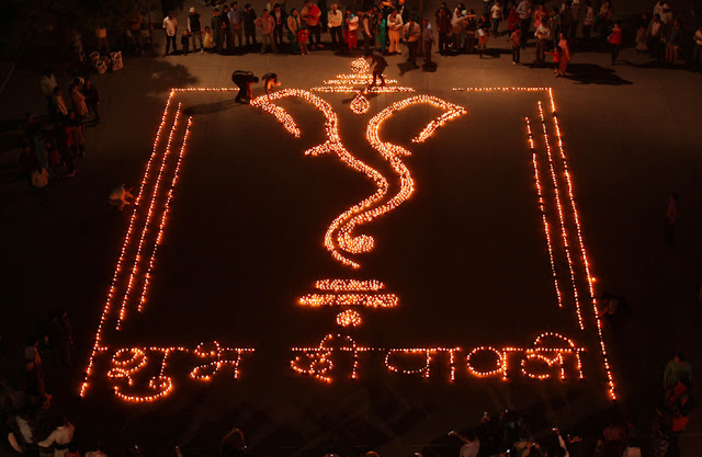diwali firecrackers ganesha image made by diyas