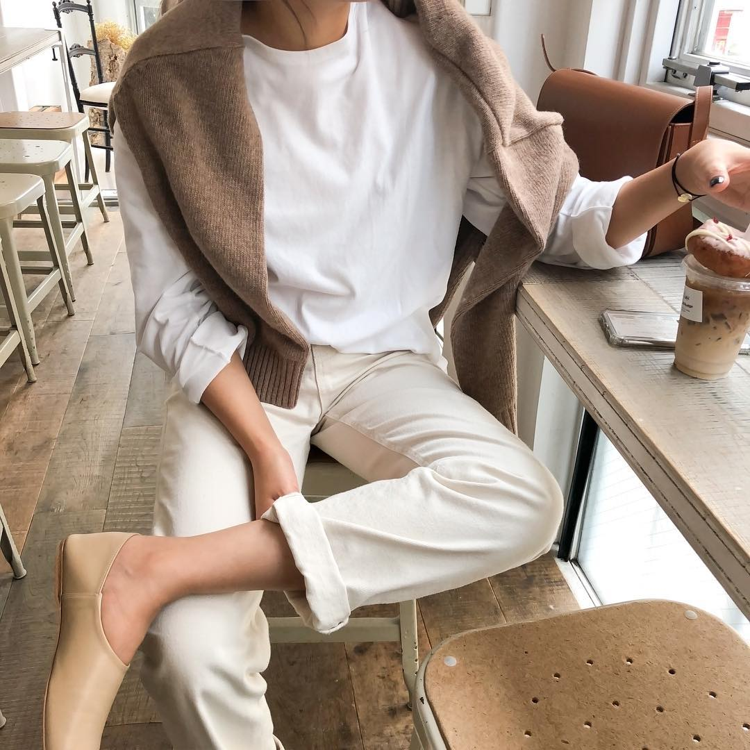 Neutral Spring Outfit for Self-Quarantine: Brown Sweater, White Longsleeve T-Shirt, Off-White Jeans, and Neutral Flats