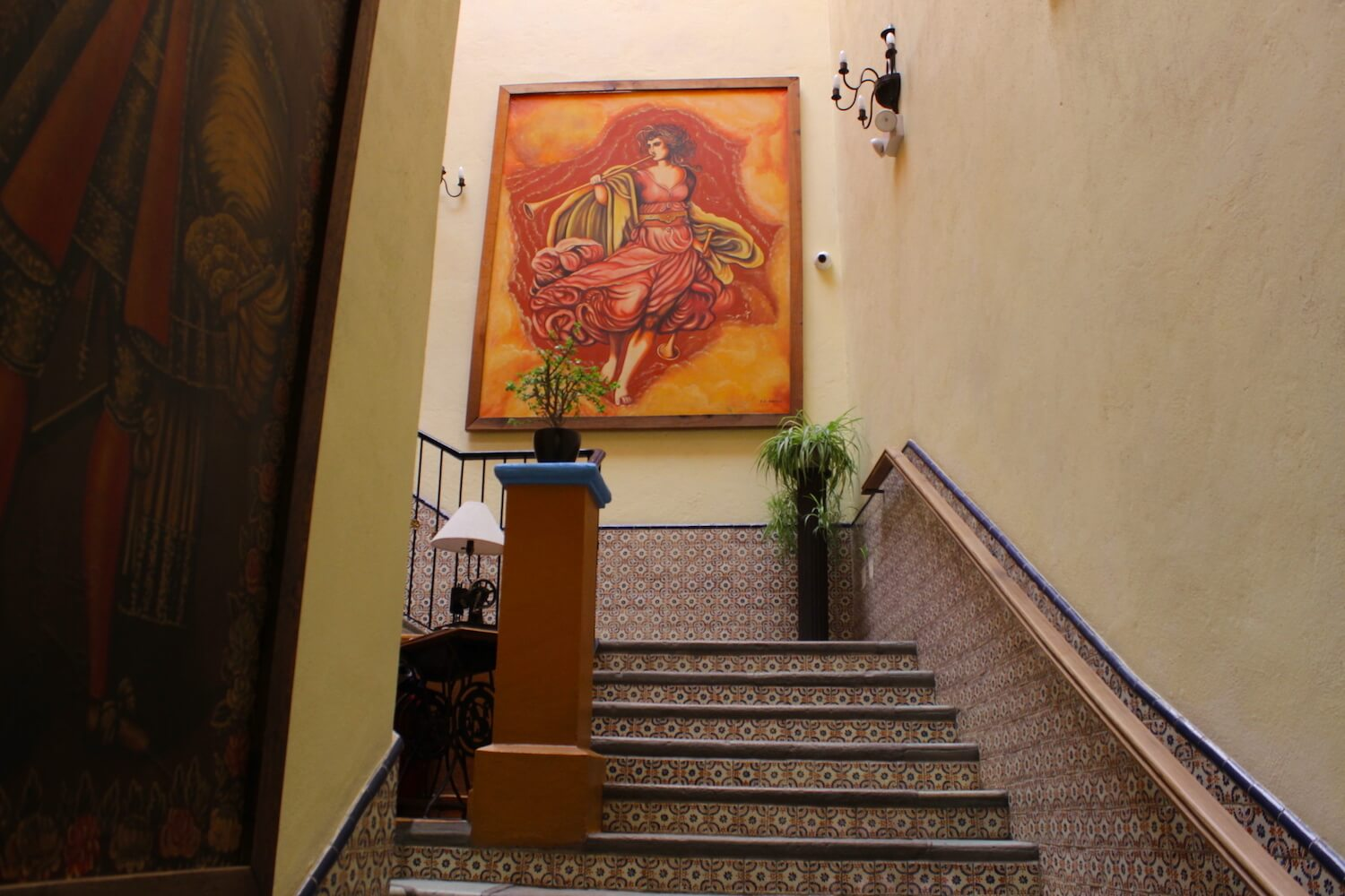 guanajuato hotel staircase with paintings