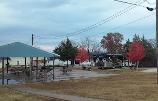 paved covered picnic area and motorhome on a rainy day