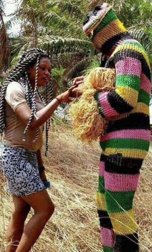 See Photo of Masquerade Proposing To Girlfriend In Abia State