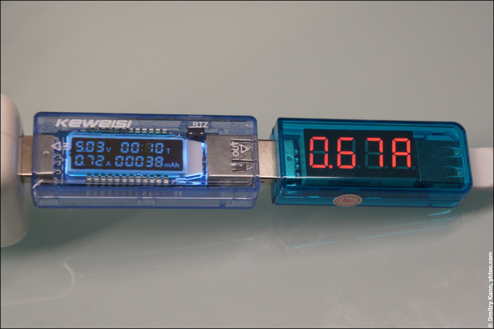 Measuring current by both testers, Apple iPod DC adapter.