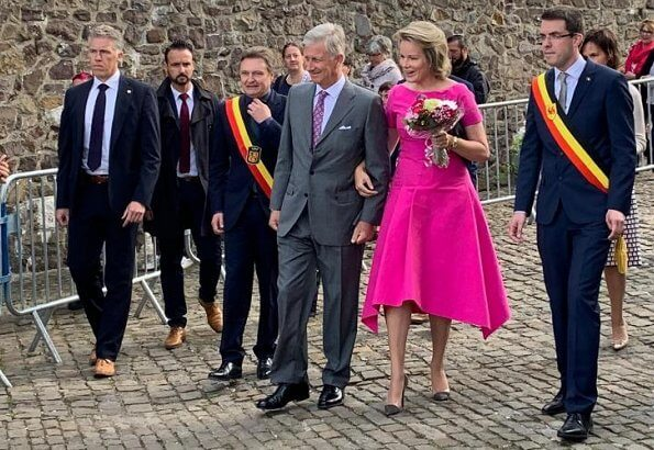 Queen Mathilde wore a pink asymmetric midi dresses by Natan.Arthur Regniers medical and pedagogical center