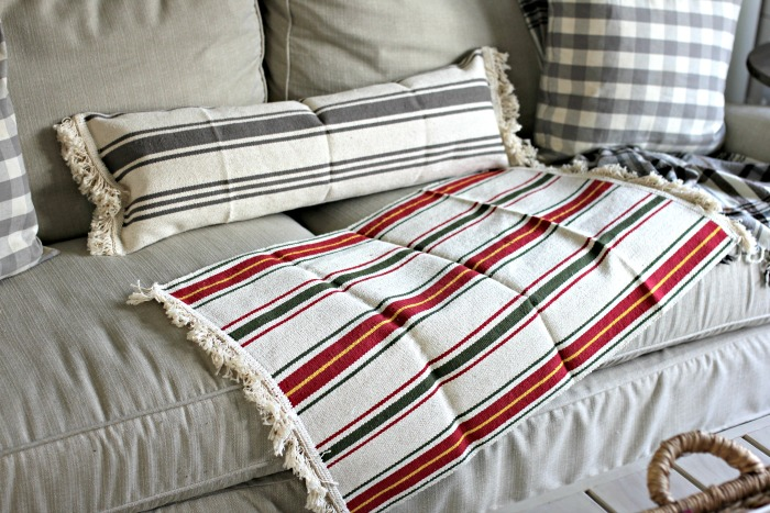 Ikea Signe throw rug made into DIY lumbar pillow - www.goldenboysandme.com