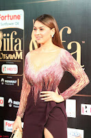 Hansika Motwani in Glittering Deep Neck Transparent Leg Split Purple Gown at IIFA Utsavam Awards 41.JPG