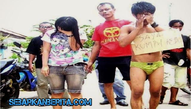 Ketahuan Selingkuh Di Hotel , PNS Ponorogo Dan Selingkuhannya Diarak Di Balai Desa.