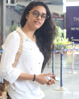 Keerthy Suresh in White Dress with Cute and Awesome Lovely Smile at Hyderabad Airport 3