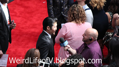 Bryan Tee being interviewed on the red carpet - Jurassic World Premiere