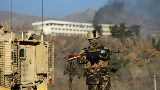 Image Attribute: Afghan security forces keep watch near the Kabul Intercontinental Hotel following the attack. Source: AFP
