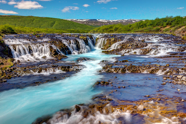Turquoise Bruarfoss waterfall during Iceland's summer