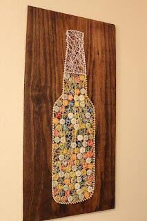quadro con bottiglia birra in string art