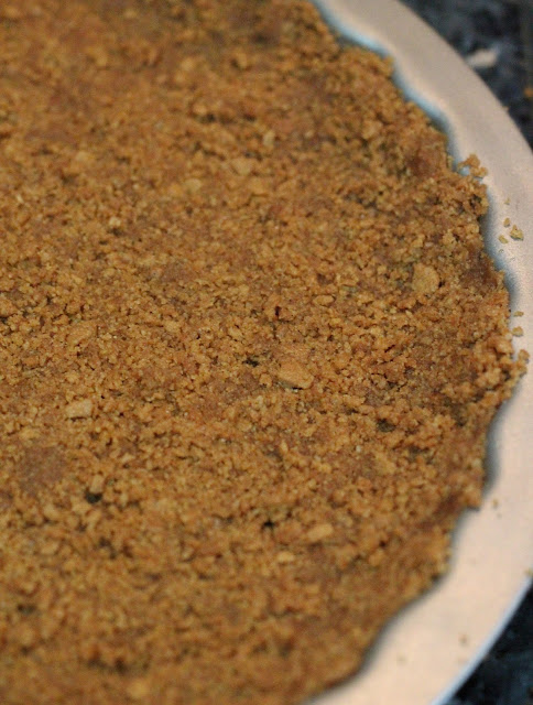 Pour the crumb mixture into the prepared tart pan, spread it out and ...