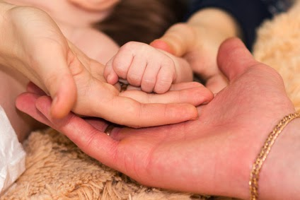 Mother's hands, Father's hands, the hand of an infant