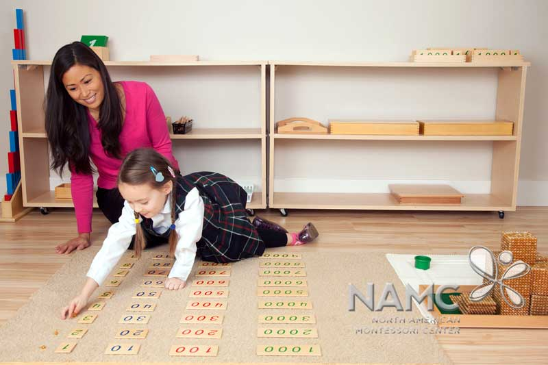 NAMC montessori student and teacher working in prepared environment