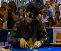 Stu Ungar rechecks his cards... or card... or part of a card