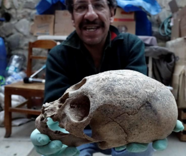 Archaeologist Jedu Sagarnaga holds a skull that is definitely strange and could be influenced by Ancient Aliens.