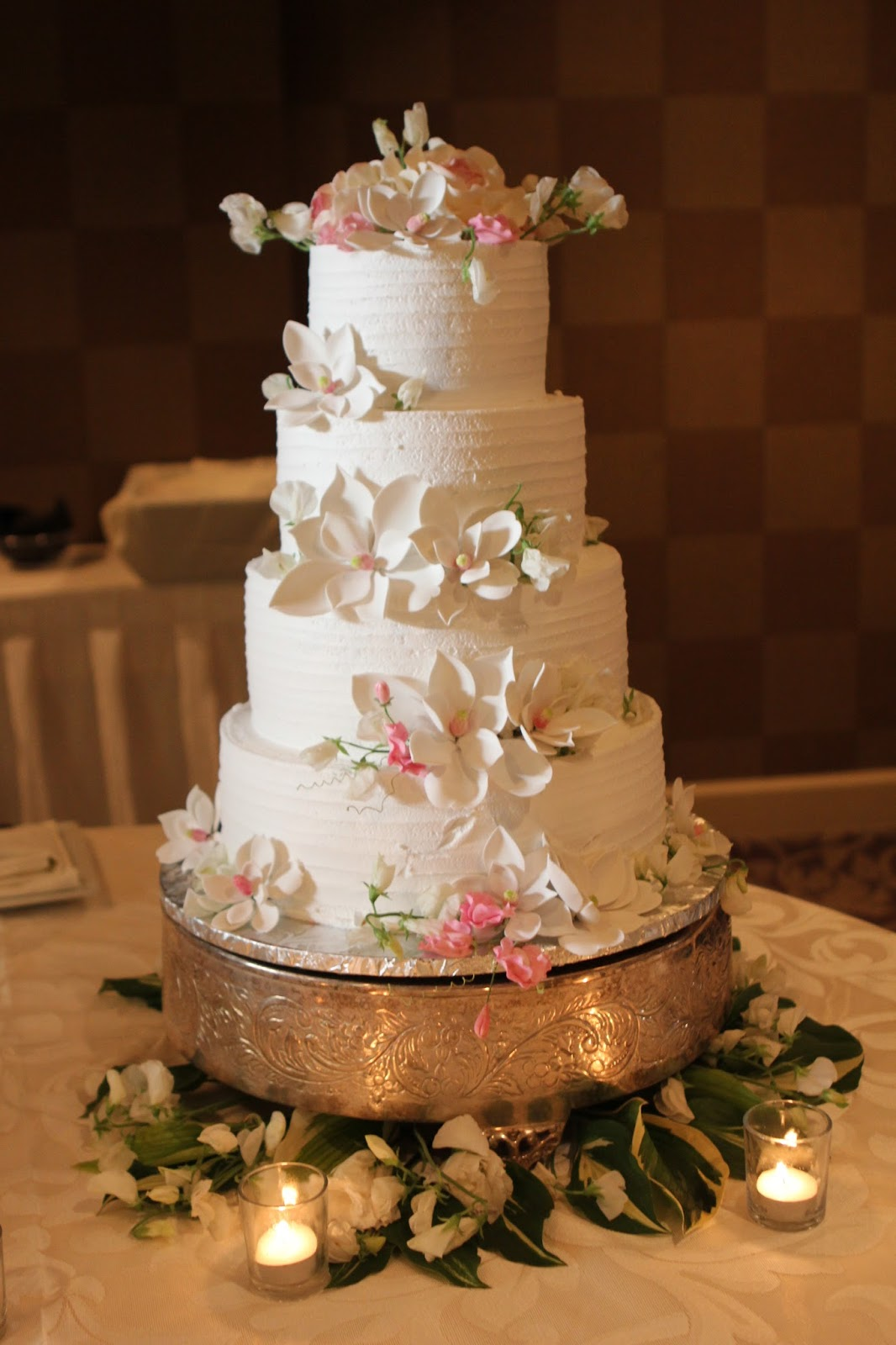 Tiered Wedding Cake On The Tray With Fresh Flowers