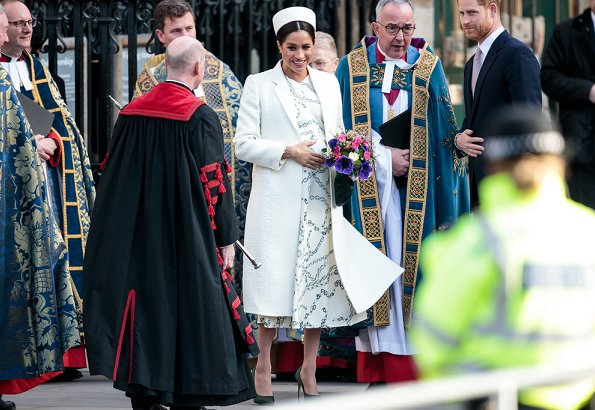 Meghan Markle wore Victoria Beckham printed crepe long sleeve midi dress, Kate Middleton wore a red coat by Catherine Walker