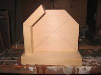 One bottom and corner piece glued together