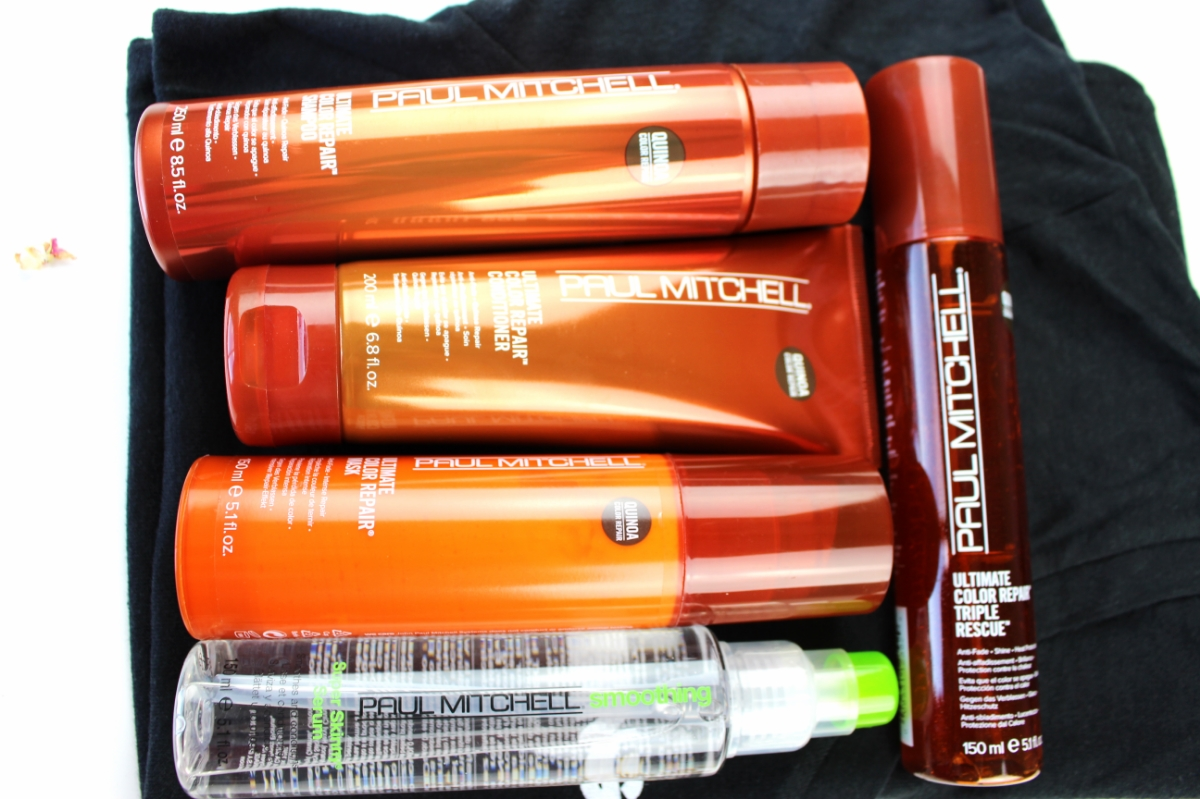 This is a flat lay of the Paul Mitchell Quinoa Repair Collection, along with the Skinny Serum.